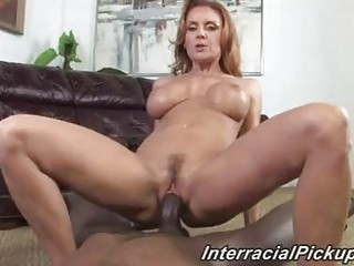 cougar brunette with awesome boobs drives brown