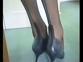 lengthy foot inside black stockings