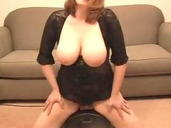 breasty lady riding a sybian