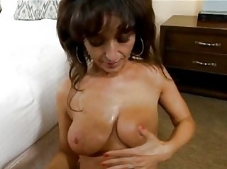 Dark haired cougar with delicious tits gets