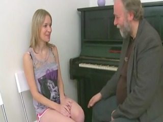 granny piano teacher bangs his young student