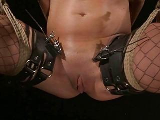 super brunette taking bondaged and punished