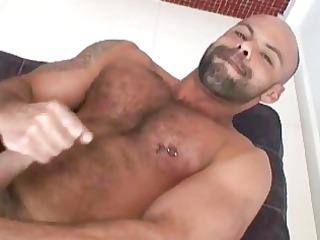 extremely slutty bearded hunk jerks off his large