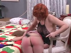pretty lesbo slut goddess spanks the hell out of