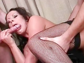 busty brunette housewife gives dual cock sucking