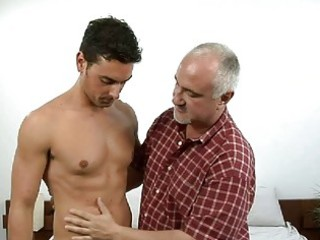 tanned muscled gay hunk and elderly daddy having