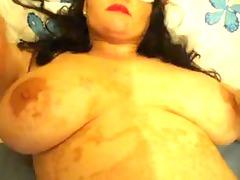 huge mature posing and licking dick