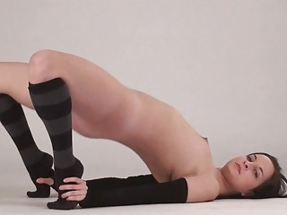 flexible black haired amateur exposes her clean
