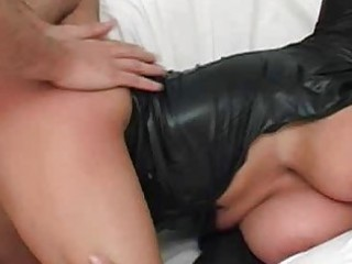 busty tanned brunette into black leather takes