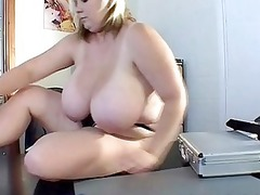 mega boobed blonde milf shows off her large jugs